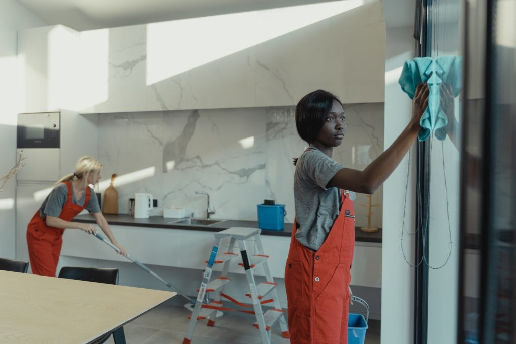 two Cleaners cleaning a kitchen
